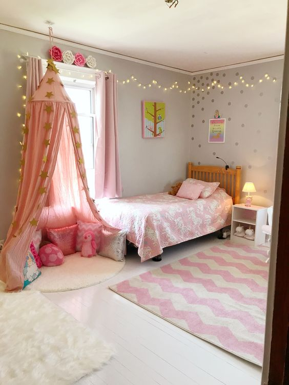 girls bedroom decor ideas string lights pink reading nook pillows gold polka dots canopy accent rug tamcam10