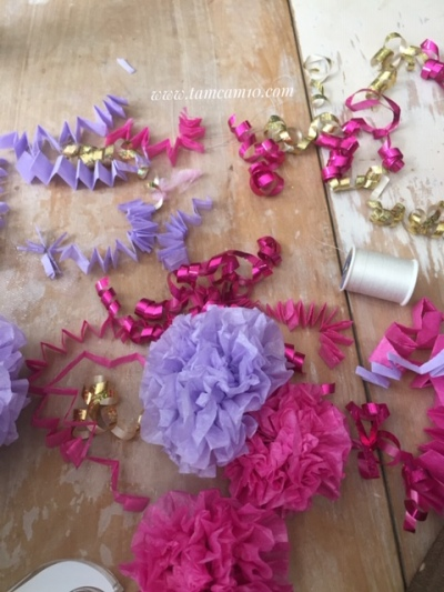 Pink and Purple tissue paper puffs, Pink and gold curling ribbon, white thread.