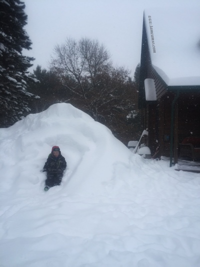 Wisconsin Winter Huge Snow Pile Kid in Snow