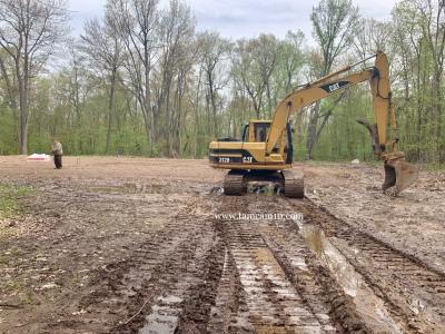 Excavating CAT tamcam10